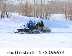 Small photo of Pavlodar, Kazakhstan - January 15, 2017: Passengers on a towable tube on the frozen river at rest