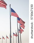 american flags arranged in a... | Shutterstock . vector #573067150