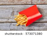 pack of fries on wood. fries... | Shutterstock . vector #573071380