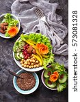 buddha bowl. healthy vegetarian ... | Shutterstock . vector #573081328