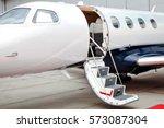 ladder with open door in...   Shutterstock . vector #573087304