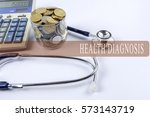 a stethoscope with piles of... | Shutterstock . vector #573143719
