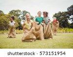 children having a sack race in... | Shutterstock . vector #573151954