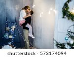 young couple in love have fun... | Shutterstock . vector #573174094