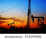 Small photo of The evening of the oilfield, pumping unit and the silhouette of oilfield derrick