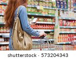 customer walking around a store ... | Shutterstock . vector #573204343