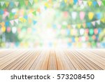 empty wooden table with party... | Shutterstock . vector #573208450