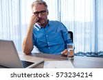concentrated businessman in the ... | Shutterstock . vector #573234214