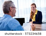 two smiling businessmen in the... | Shutterstock . vector #573234658