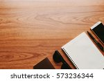 blank notebook on wood table... | Shutterstock . vector #573236344