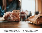 hand of woman using smartphone... | Shutterstock . vector #573236389