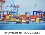 tugboat and crane in harbor... | Shutterstock . vector #573246568