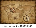 wood airplane over world... | Shutterstock . vector #573251140