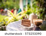 chocolate cake and coffee on... | Shutterstock . vector #573253390
