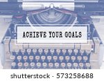 Small photo of ACHIEVE YOUR GOALS text with vintage typewriter.