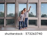 two little  boy in jeans and... | Shutterstock . vector #573263740