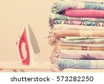 ironing board  iron and clothes  | Shutterstock . vector #573282250