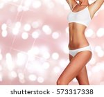 slim woman body on an abstract... | Shutterstock . vector #573317338