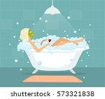 woman in taking a bubble bath... | Shutterstock .eps vector #573321838
