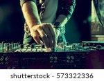 dj playing music at mixer... | Shutterstock . vector #573322336