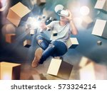 visual reality concept.young... | Shutterstock . vector #573324214