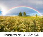 rainbow over a field of wheat | Shutterstock . vector #573324766