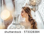 close up portrait of young... | Shutterstock . vector #573328384