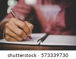 hipster right hand writing on... | Shutterstock . vector #573339730