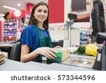 portrait of woman cashier... | Shutterstock . vector #573344596