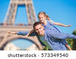 happy family in paris near... | Shutterstock . vector #573349540