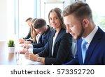 smiling businesswoman looking...   Shutterstock . vector #573352720