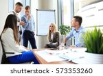 team young professionals having ... | Shutterstock . vector #573353260