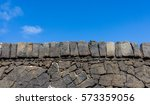 stone wall with blue sky... | Shutterstock . vector #573359056