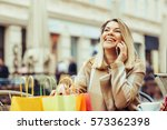 young woman  talking on the... | Shutterstock . vector #573362398