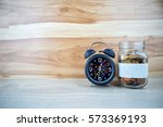 jar golden coin and alarm clock ...   Shutterstock . vector #573369193