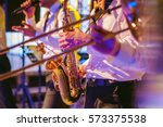 musician plays the saxophone... | Shutterstock . vector #573375538