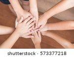 school kid volunteer's hands... | Shutterstock . vector #573377218