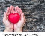 red love heart on woman's hand... | Shutterstock . vector #573379420