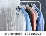 fashionable clothes hanging on... | Shutterstock . vector #573386026