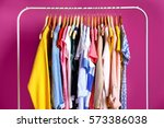 Fashion Clothing On Hangers At...