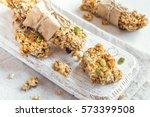 organic homemade granola bars... | Shutterstock . vector #573399508