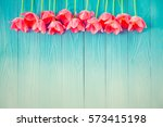 top view of tulips on wood...   Shutterstock . vector #573415198