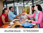 casual business team giving... | Shutterstock . vector #573420004