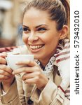 happy woman enjoying a cup of... | Shutterstock . vector #573432010
