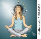 vector woman meditating in... | Shutterstock .eps vector #573444010