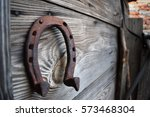 Old Rusty Horseshoe On A Woode...