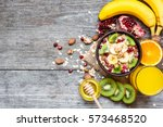 oatmeal porridge with banana ... | Shutterstock . vector #573468520