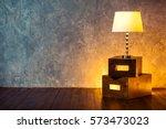 floor retro lamp on two boxes...   Shutterstock . vector #573473023