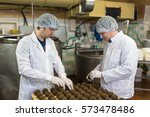 cheese at the dairy  two... | Shutterstock . vector #573478486