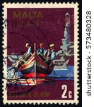 Small photo of SINGAPORE – FEBRUARY 7, 2017: A stamp printed in Malta shows Luzzu and aircraft carrier, circa 1979